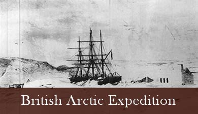 A historic photograph of HMS Discovery, trapped in sea ice. An old  black and white photogragh of the  HMS Discovery, a fully rigged sailing ship, trapped in sea ice.