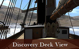 The images in this gallery provide a panoramic view of the landscape surrounding Discovery harbour from the deck of the ship. Rocky hills are visible, as is a tent and the post office cairn built by members of the British Arctic Expedition. Pans of sea ice float in the harbour. Deck details include lifeboats hanging from hooks and the wheelhouse and ships wheel.