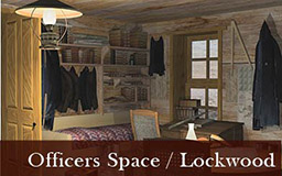 The images in this gallery provide a panoramic view of James Booth Lockwood's quarters. As we move 360 degrees around the space, we see Lockwood's bed with a desk beside a window. On the desk sits a telescope and some books. Clothing is hung above the bed. Also visible from Lockwood's space is Greely's quarters, the pendulum room, and a doorway leading to other areas of the expedition house