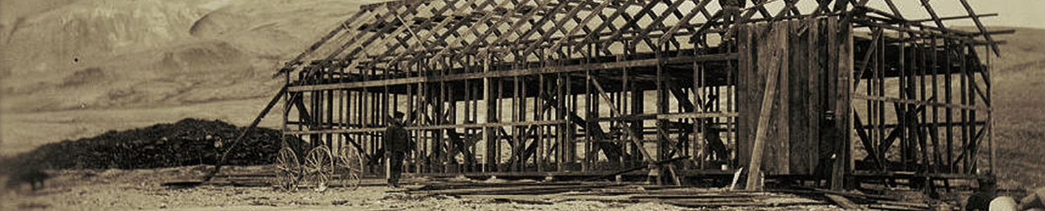 A historic photograph showing the construction of the expedition house used by the Lady Franklin Bay Expedition.
