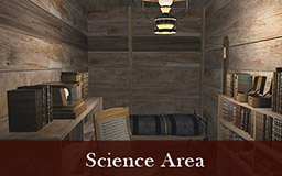 The images in this gallery provide a panoramic view of the science area. Shelves along both walls of this narrow space are filled with a variety of scientific instruments, including chronometers and wind speed recorders. Bookshelves and a small bed are also visible.