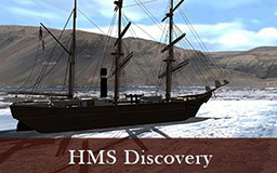 The images in this gallery provide a rotating view of the ship HMS Discovery. The ship is depicted afloat in Discovery harbour with pans of ice all around. The ship has three masts plus rigging and her sails have been stowed. Lifeboats hang from hooks above the deck. Features such as the wheelhouse are visible on the deck. The post office cairn built by the British Arctic Expedition is visible on the shore.