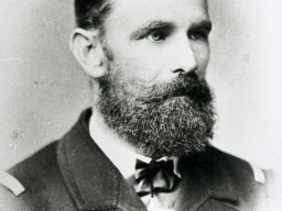 A portrait of Karl Weyprecht. He is dressed formally and has a beard.