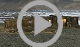 An animation that rotates 360 degrees showing all three Peary huts. The rectangular huts all face one another and are constructed of wood that now appears weathered.